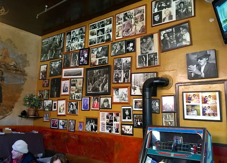 Pictures on the wall of the Caffe Trieste.