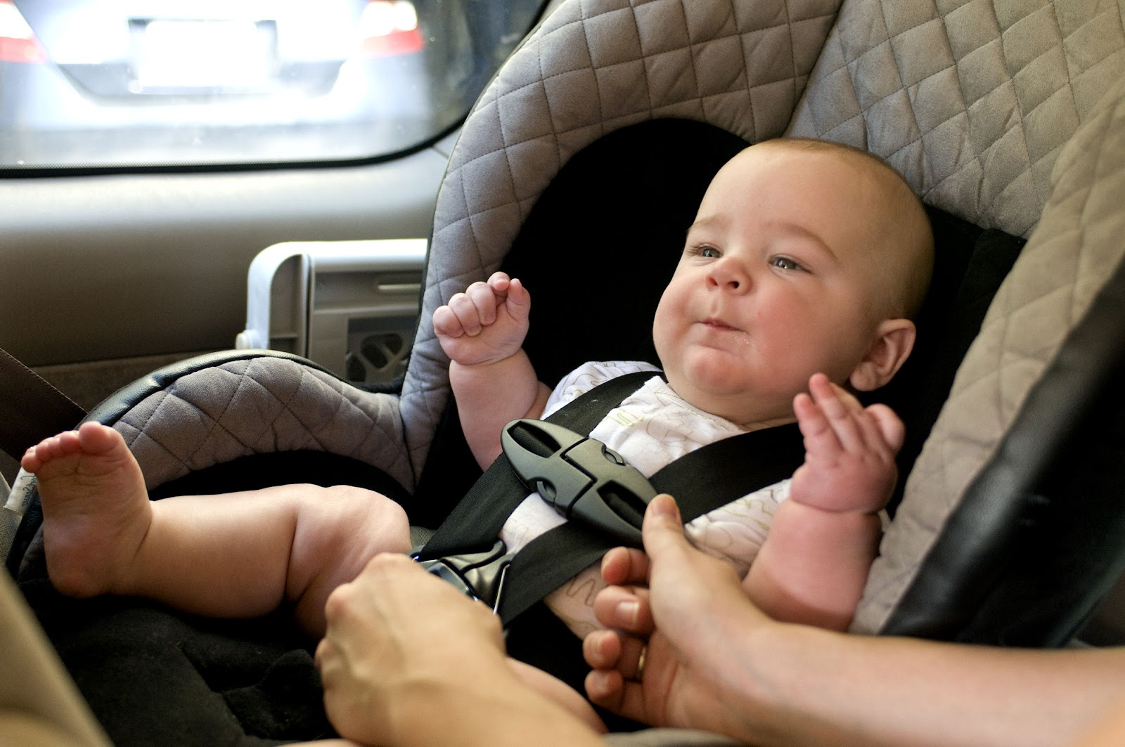 baby-in-a-back-seat-located-child-safety-seat.jpg