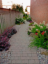 Photo: Pathways needn't be straight. Curve them through the garden and soften the edges with plantings.
