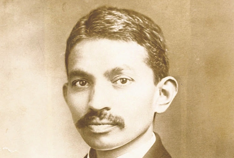 A moustached young Mohandas Gandhi.