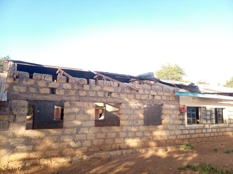 Classrooms affected by strong winds at Ayatya primary school in Barwessa, Baringo North sub-county on Monday.