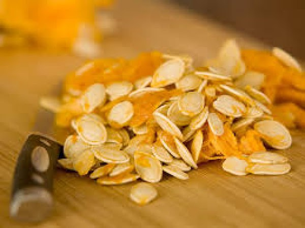 Clean out your Pumpkin, Add seeds to a big bowl and pull out stringy...