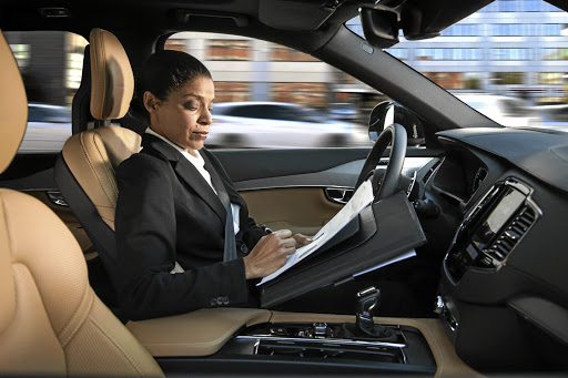 We might think that autonomous cars will allow us to work or rear the paper but a human will still need to be able to take control for many years yet. Picture: NEWSPRESS UK