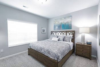 Daphne floorplan spacious bedroom with plush carpet