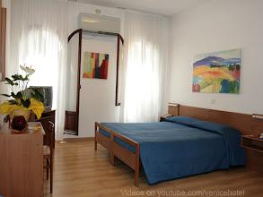 Photo: HOTEL CAPRERA - Part of a QUADRUPLE ROOM