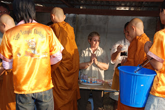 """Photo: The TIGER TEMPLE in Kanachanaburi, Thailand is run by about 17 monks, who depend on local """"offerings"""" of food to eat one meal a day (breakfast).  They walk in a line and receive the food..."""