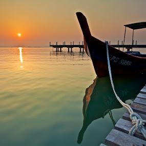 rising sun by Christopher Harriot - Landscapes Sunsets & Sunrises ( penang, sea, malaysia, sunrise, boat, dock )