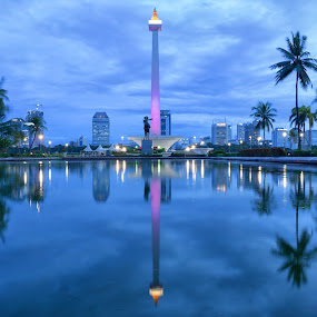 The National Monument in Jakarta by Saiful N. Firmansyah - Buildings & Architecture Statues & Monuments ( building, reflection, indonesia, sunset, blue hour, monas, monument, jakarta, long exposure, landscape, slow speed,  )