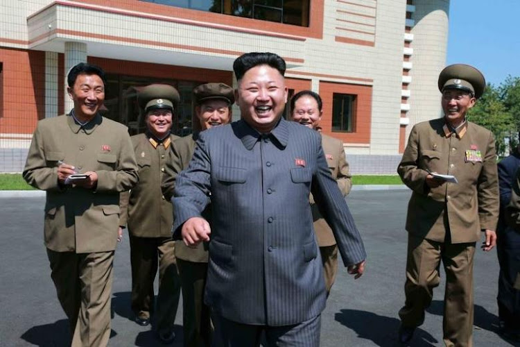 North Korean leader Kim Jong Un and friends. Picture: REUTERS