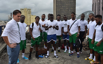 Photo: Coach McKinstry speaks to players ahead of their game, from the rooftop of their 10 storey hotel [Leone Stars v Ivory Coast, 6 September 2014 (Pic © Darren McKinstry / www.johnnymckinstry.com)]