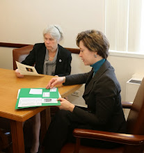 Photo: BBA President-Elect Julia Huston sat down with Representative Alice Peisch and showed her some of the telling materials about the need for increased civil legal aid in Massachusetts.