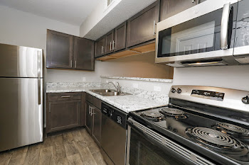 B5R Kitchen with Stainless Steel Appliances and Dark Cabinets