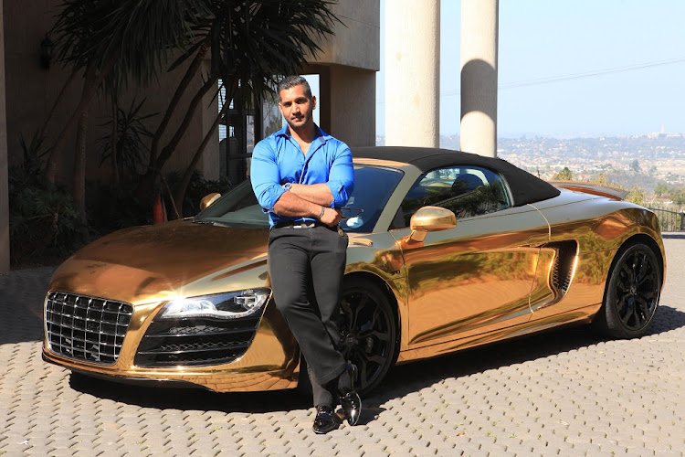 Rajiv Narandas in happier days next to his gold wrapped Audi R8.