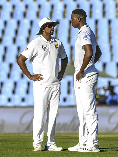 What's the plan: Vernon Philander, left, and Lungi Ngidi discuss tactics during the second Test against India at Centurion. The pair are likely to feature prominently in the third Test at the Wanderers. Picture: SYDNEY SESHIBEDI/GALLO IMAGES