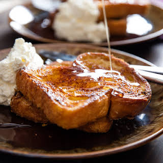 Orange-Rum Challah French Toast With Whipped Cream.