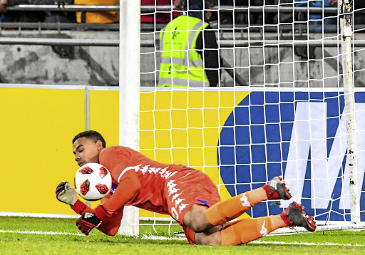 Dive master: Ronwen Williams of SuperSport United saves a penalty that helped his team defeat Orlando Pirates in an MTN8 quarterfinal game late on Saturday night. Picture: SYDNEY SESHIBEDI/GALLO IMAGES