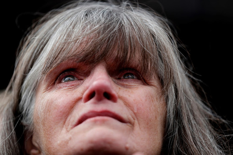 A supporter cries as US President Donald Trump speaks during a campaign rally for Republican Senate candidate Matt Rosendale in Belgrade, Montana.
