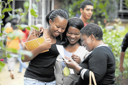 Some matrics, like Amanda Mntambo of Greenside High, left, had reason to celebrate this week when their results were announced. Sharing her joy is her sister, Gugu Mntambo, and mother, Linda Mntambo. File photo