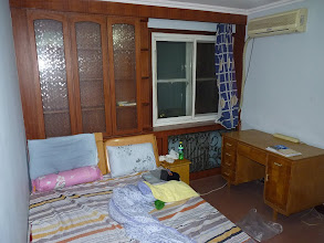 Photo: Beijing - my new warm room with window, AC, desk, bed and one wardrobe (and of course normal mess, but it's actually cleaner, this is just after unpacking grocery) after they moved the other to new room, 1500RMB + utilities, photo taken 111201