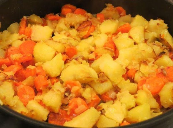 While the meat and stock are simmering, prepare the veg. Melt the butter in...