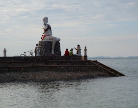 Photo: Not sure why this statue is out on this pier