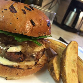 Organic Beef Burger with Maple Caramelized Onion, Brie, and Horseradish Aioli.