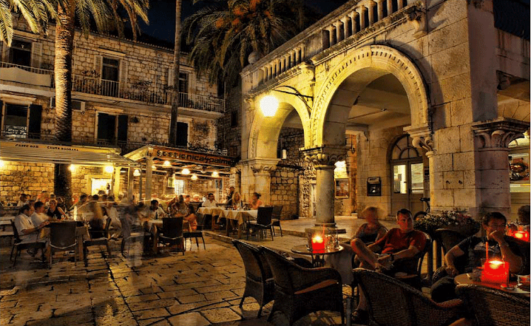 Evening in a public courtyard in Hvar city on Hvar island, Croatia.