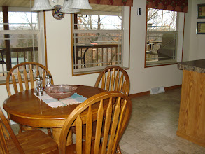 Photo: Lakeside kitchen windows catch wonderful view of lake and have insulated shades.