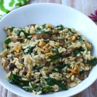 Vegan Spinach And Mushroom Risotto With Toasted Walnuts.