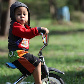 my son on bike by Puguh Widura - Babies & Children Toddlers ( canon, model, batik, candid, son )
