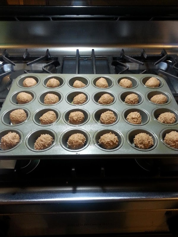 Spray mini muffin pan with Pam. Take a teaspoonful of batter and roll into...