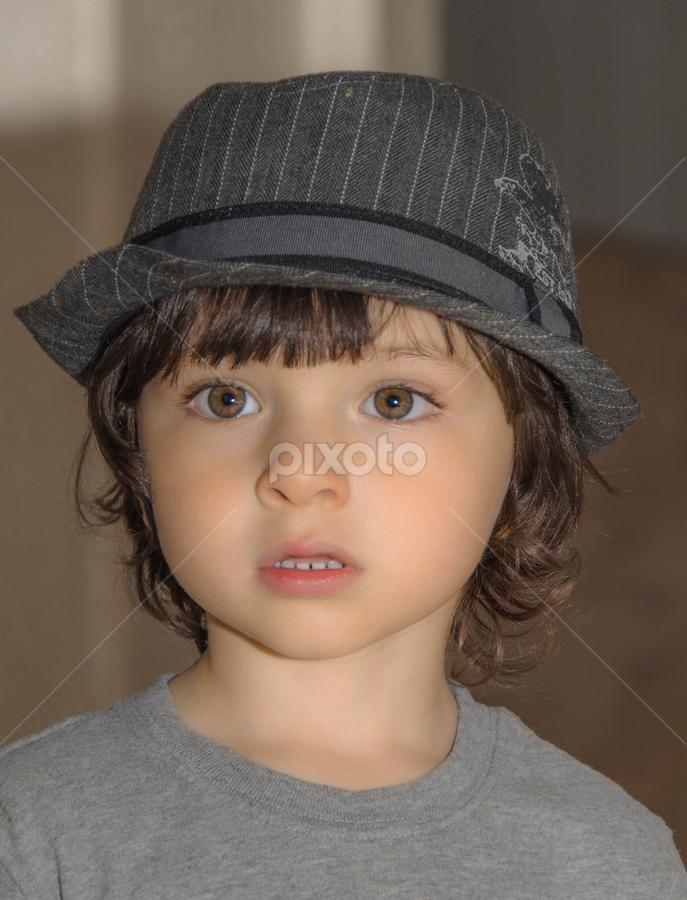 Just Handsome by Patricia Kousaleos - Babies & Children Child Portraits ( child, handsome, boy, eyes, hat )
