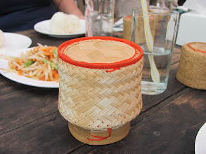 Photo: They brought out our sticky rice in these.