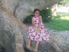 Photo: Kaleya poses on the roots of the Kapok tree