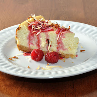 White Chocolate Coconut Cheesecake with Raspberry Drizzle