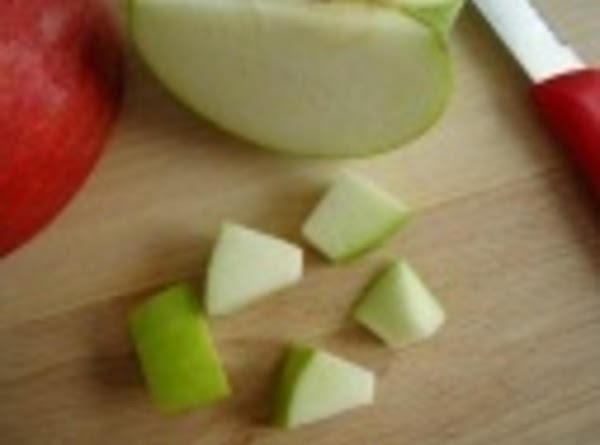 First prepare your veggies or fruit. If you are using apples, cut them in...