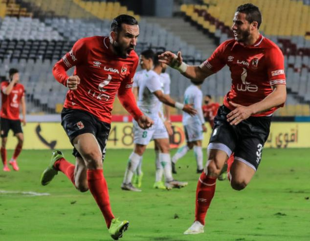 Tunisian international Ali Maaloul (L) celebrates after scoring one of the two goals in Al Ahly's 2-0 league win over Al Ittihad away in Alexandria on Tuesday April 3 2019.