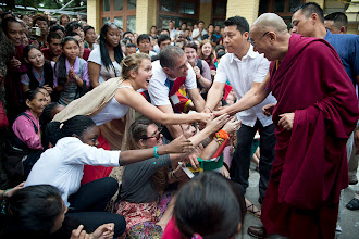 Photo: Well-wishers reach out to shake His Holiness the Dalai Lama hand on his arrival at the Main Tibetan Temple to participate in celebrations honoring his 77th birthday in Dharamsala, India, on July 7, 2012. Photo/Tenzin Choejor/OHHDL