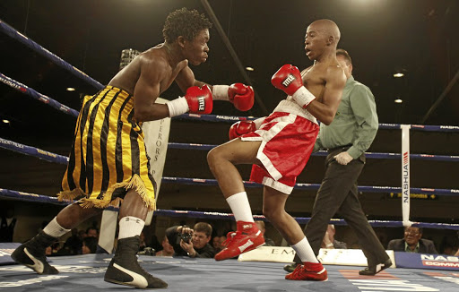 Thabang Ramagole, pictured here in a previous fight against Collen Tloubatla, registered his eighth knockout on Friday.