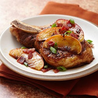 Pan Seared Pork Chops Topped with Brown Sugar Glazed Apples and Bacon