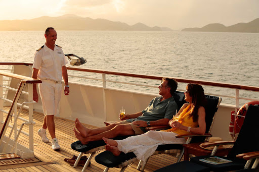 Seadream-sunset-officer.jpg - Sunset is a good time to kick back and socialize with the crew on a SeaDream cruise.