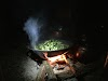 Indonesia. Papua Baliem Valley Trekking. Dinner of rice and vegetables by our Papua host
