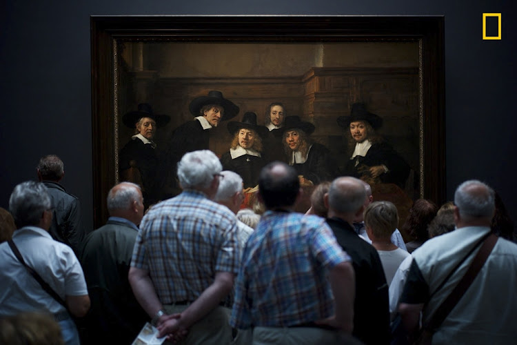'Interesting Moment' took 2nd Place in the People Category. As museum visitors look at a Rembrandt painting it appears as if the people in the painting are curiously watching them too.