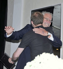 Photo: Barry Ladendorf hugs VFP-UK founder Ben Griffin after presenting him with the leadership in peace award