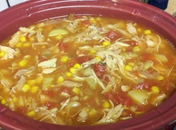 Add the chicken stock, tomatoes with juice, lima beans, corn, potatoes, and tomato sauce...