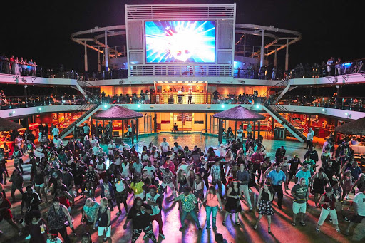 Guests celebrate during a sailaway party in Cozumel, Mexico. Join the next party on a Carnival cruise.