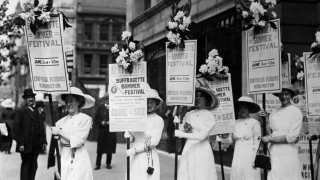 image of women protesting with signs