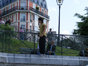 """Photo: There are many performers in the area, including these parkour practitioners (""""traceurs"""") who climb and jump from various points."""