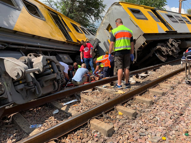 Emergency services personnel and police are on scene working to help passengers injured in a train accident in Pretoria on Tuesday. Picture: SUPPLIED