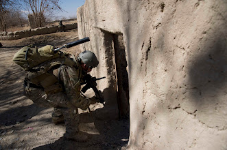 Photo: A U.S. Special Forces communications sergeant assigned to Special Operations Task Force – South enters an abandoned compound during a security patrol Feb. 20, 2011 in Panjwai District, Kandahar Province, Afghanistan. The SOTF-South Special Forces team in the area conducts regular patrols in order to secure abandoned compounds from the possible storage of explosives making material.    (U.S. Army photo by Sgt. Ben Watson)(Released).